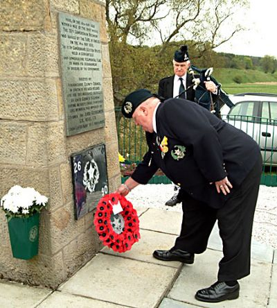 c mccready lays wreath at the cameronian cairn 2006
